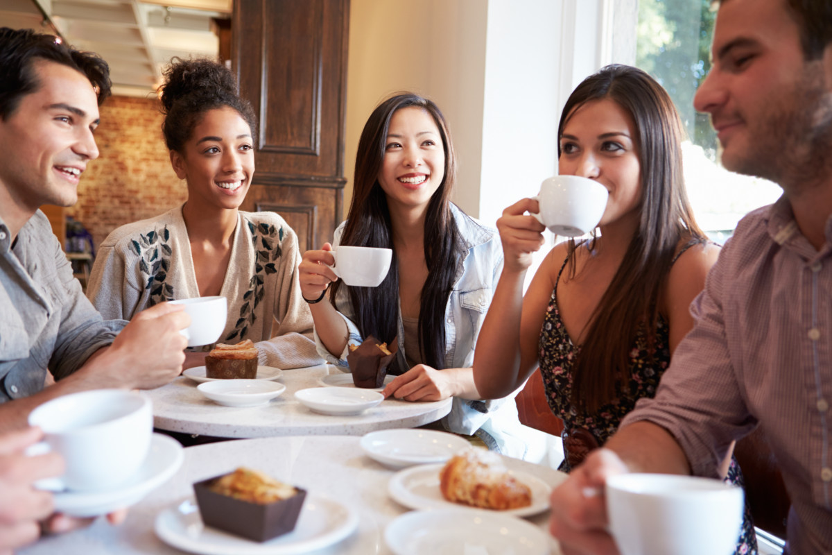 Group Of Female Friends Meeting In Café Restaurant